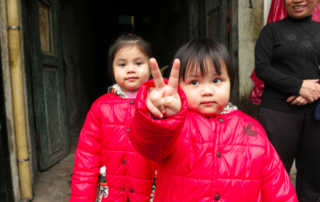 Vietnamese girls peace sign