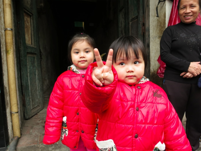 Vietnamese girls peace sign Hanoi