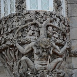 A troll holding up a bay window at the Pena Palace gives you an idea of what to expect inside: sustained weirdness.