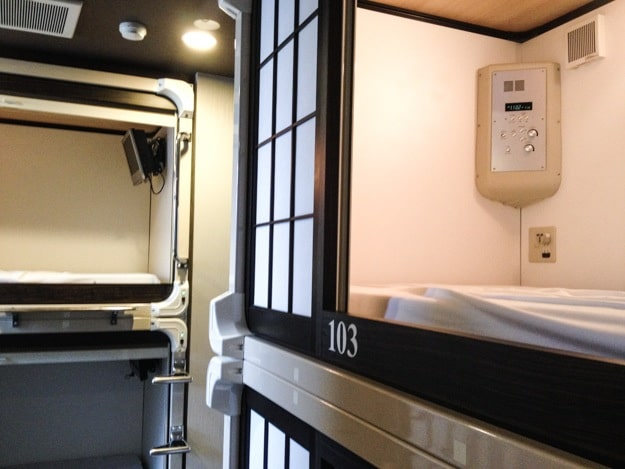 Eight sleeping capsules to a room, these feature sound and video systems, and the sliding door.