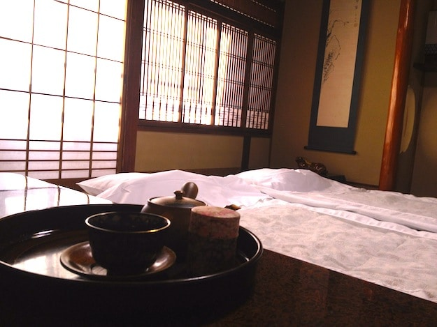 The most traditional ryokans feature sunroom seating and a recess with flowers and art.