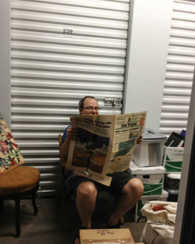 "This is Tom helping cull through storage. He's reading ""Not the Star Tribune"" parody, published by City Pages in 1994."