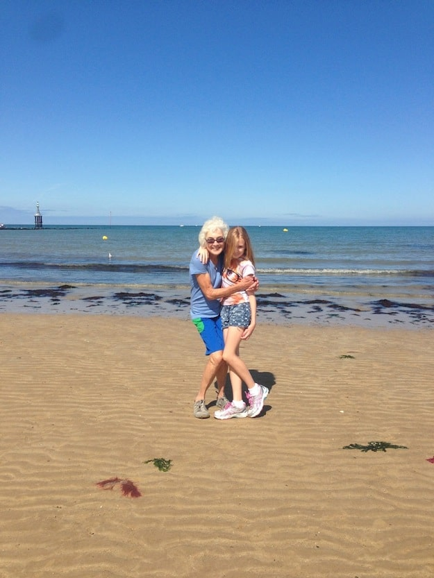 Judy with granddaughter at Normandy Beach
