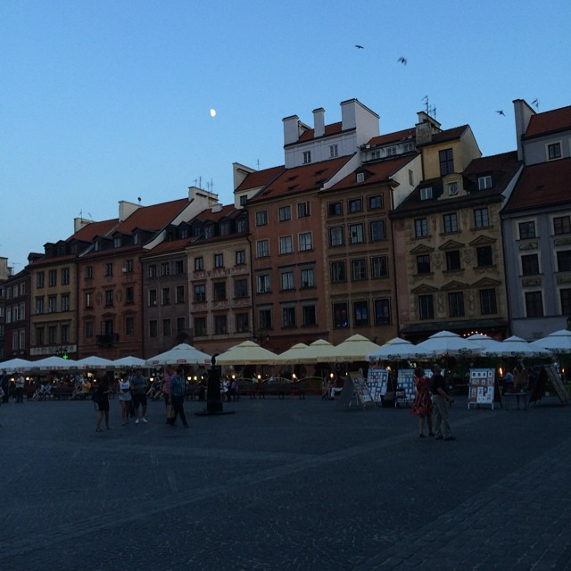 Central plaza of old Warsaw. Dusk with moon.