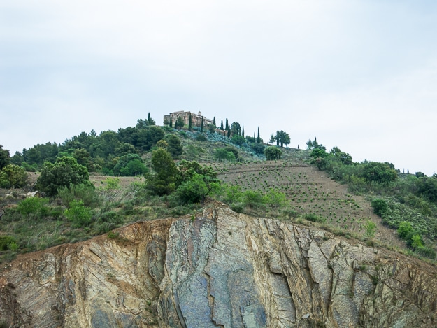 Typical steep slate mountain, planted without terraces, and a monastery on top for good measure.