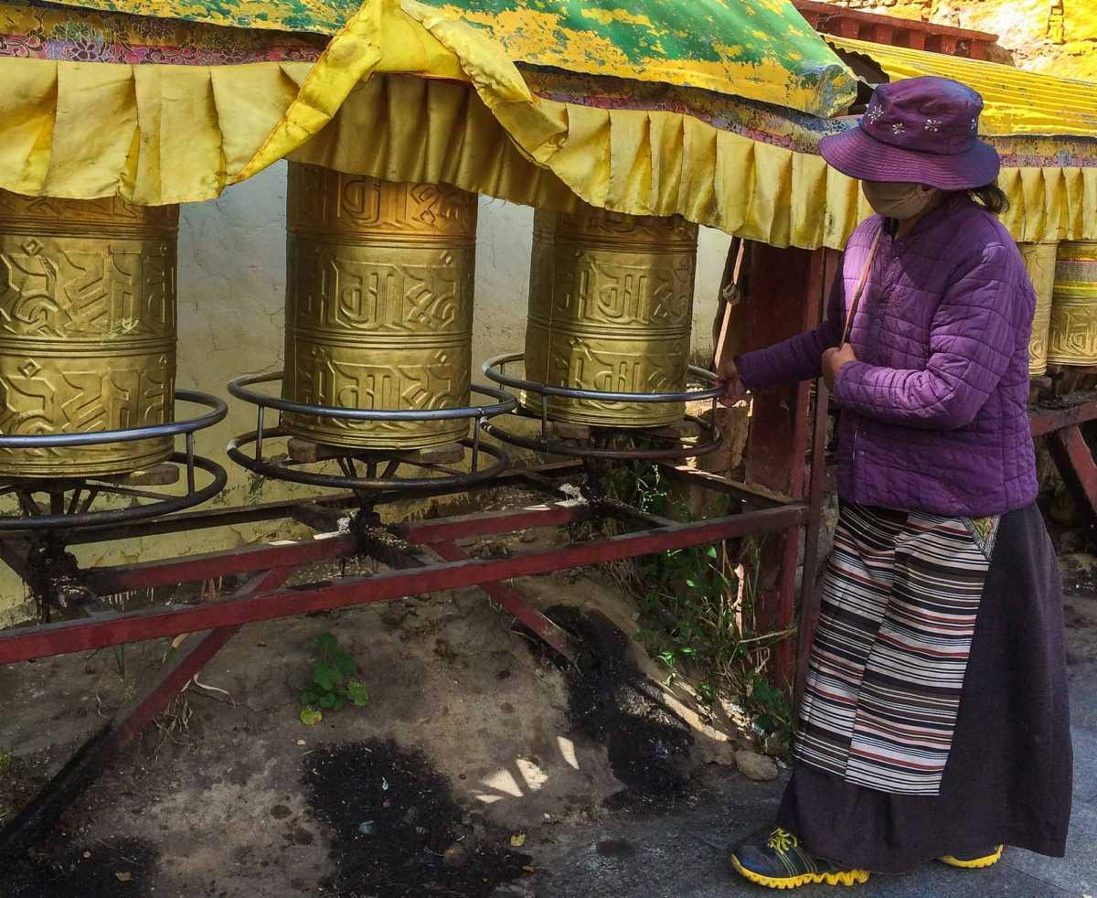 Prayer wheels outside Potala Palace, Lhasa, Tibet