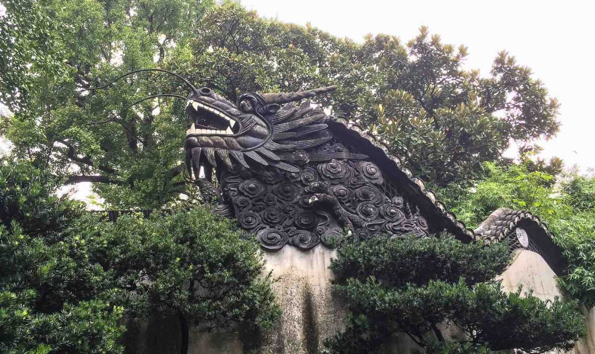 The dragon's tail drapes around the entire garden walls at Yu Garden, Shanghai
