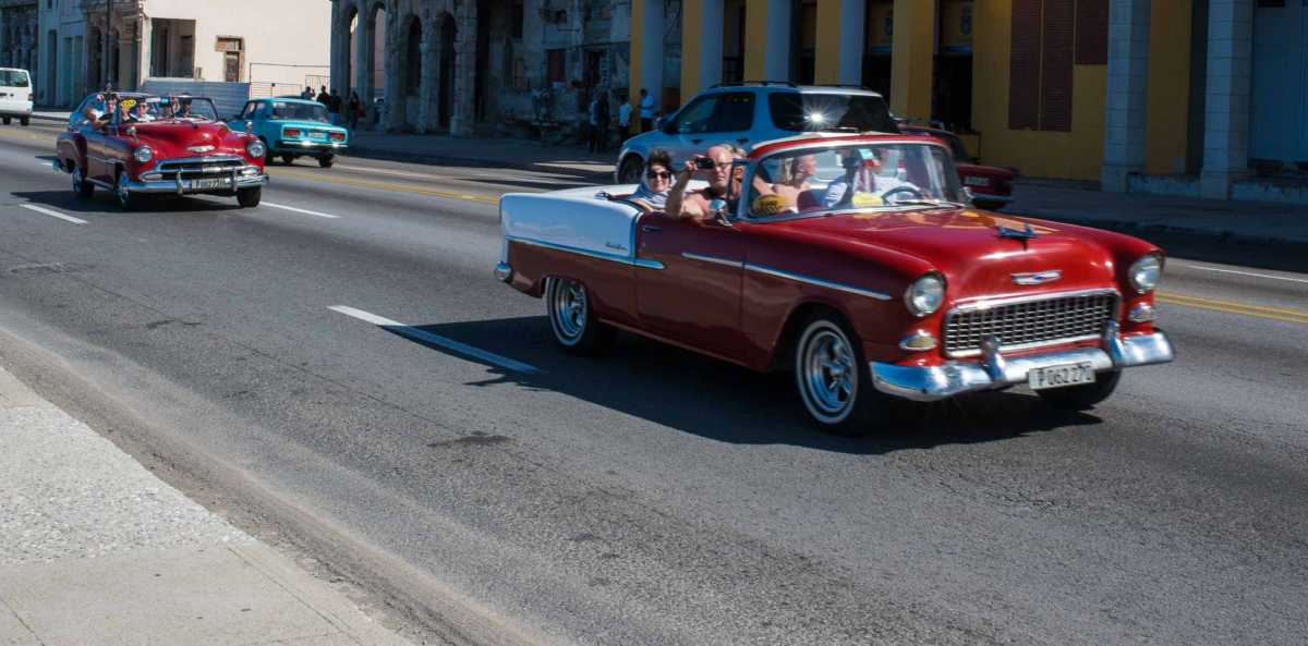 tourists in car havana