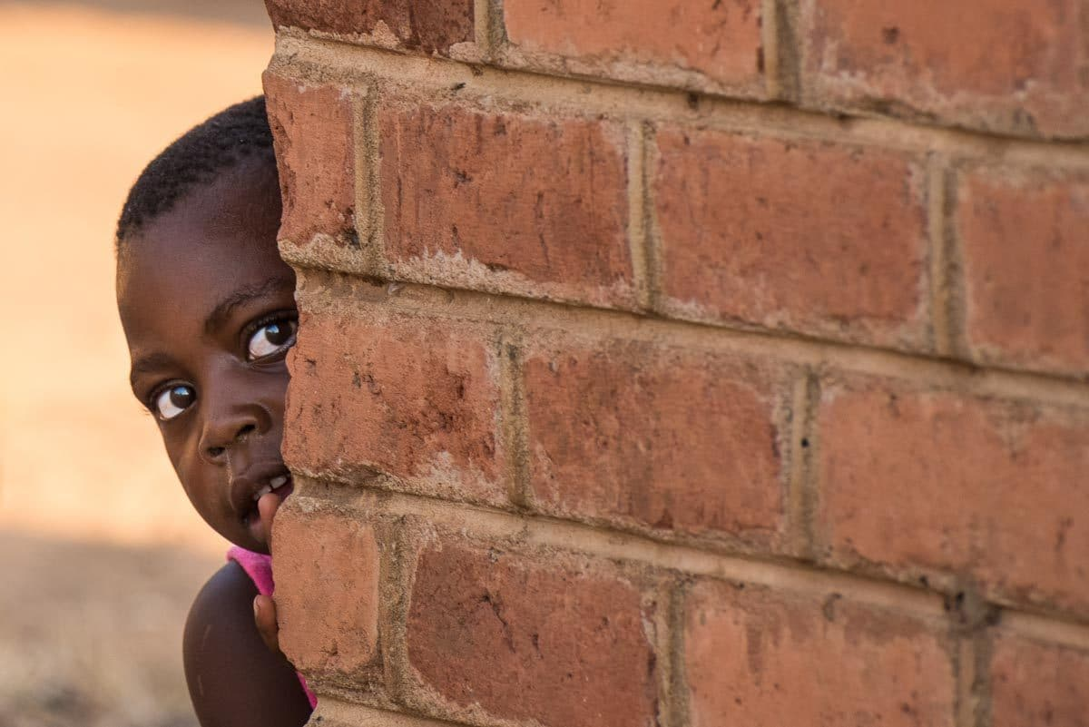 Malawi Vwaza girl in village peeking