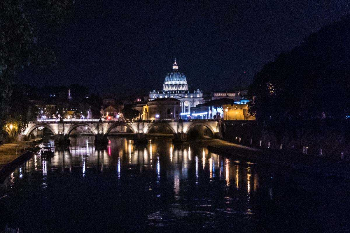 saint peters basilica reflected in the tiber rome italy